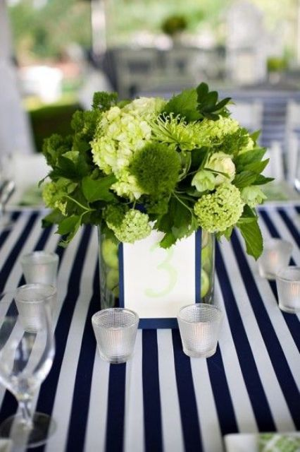 greenery and just green centerpiece contrasts with navy and white