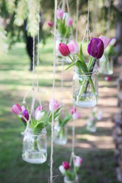 hanging jars with tulips that are truly spring flowers