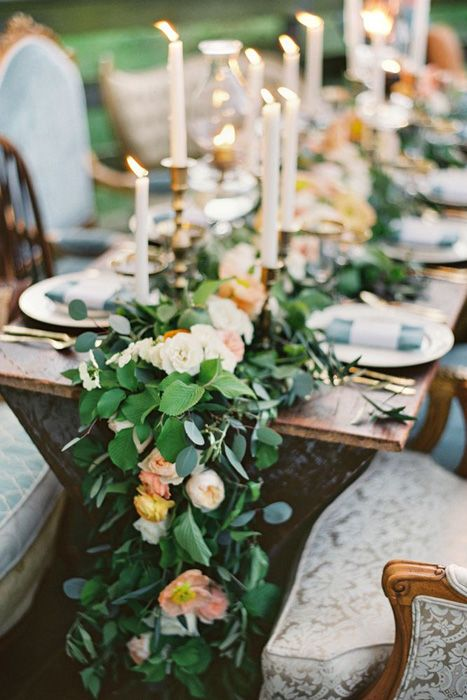 lush greenery and peach colored flower garland for table decor
