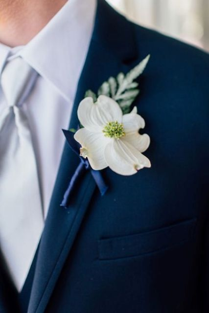 Picture of navy suit a white shirt and tie a white flower boutonniere mightylinksfo