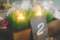 16 a box with wheatgrass and candles is a nice and fresh spring centerpiece
