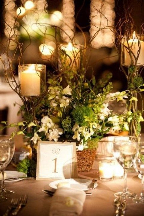 greenery and flowers with candles for the table decor