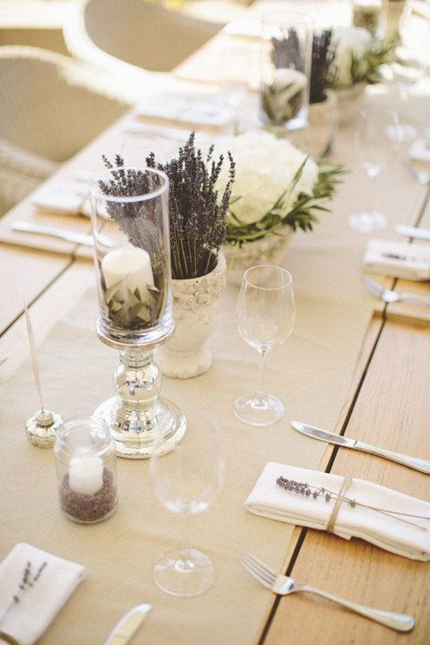 lavender, candles and large penoies that line the table