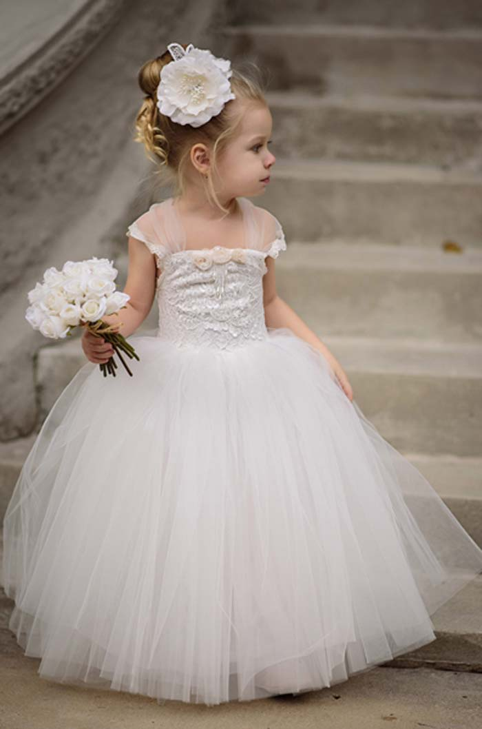 princess dress with tulle sleeves and skirt and a lace bodice