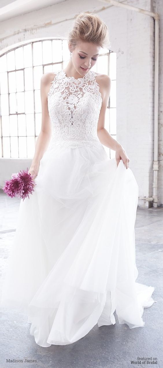 sheer lace wedding dress with a flowy skirt by Madison James