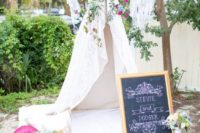 17 a teepee topped with bold flowers, a dream catcher