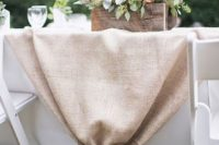 17 burlap table runner and a crate with flowers for a rustic table setting