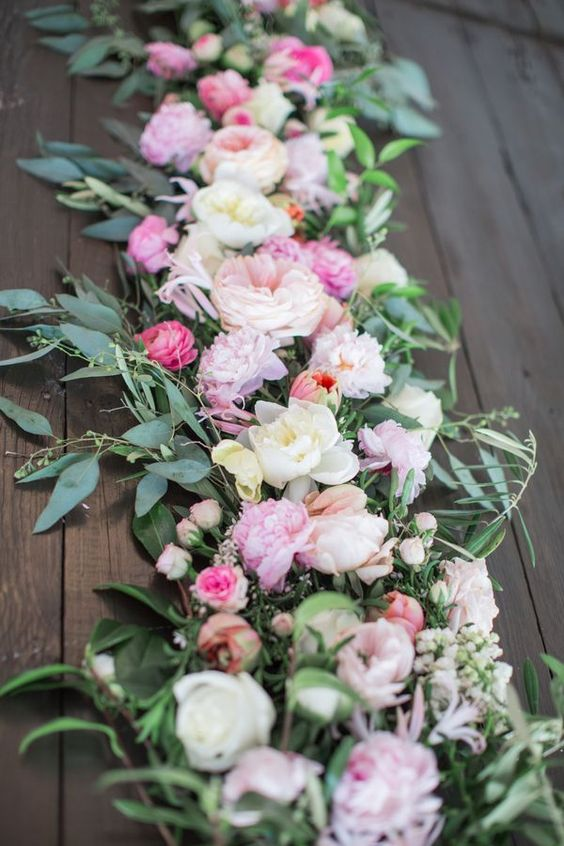 fresh floral table runner with pink flowers of different shades