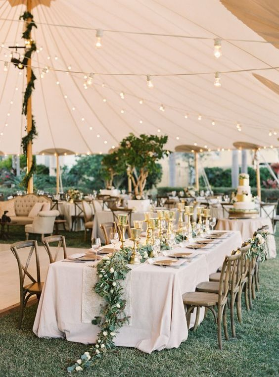 hire a tent to avoid weather surprises and decorate it with neutrals for a Spring garden wedding