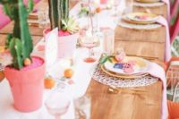 18 bold and pastel tablescape with cacti and a floral table runner