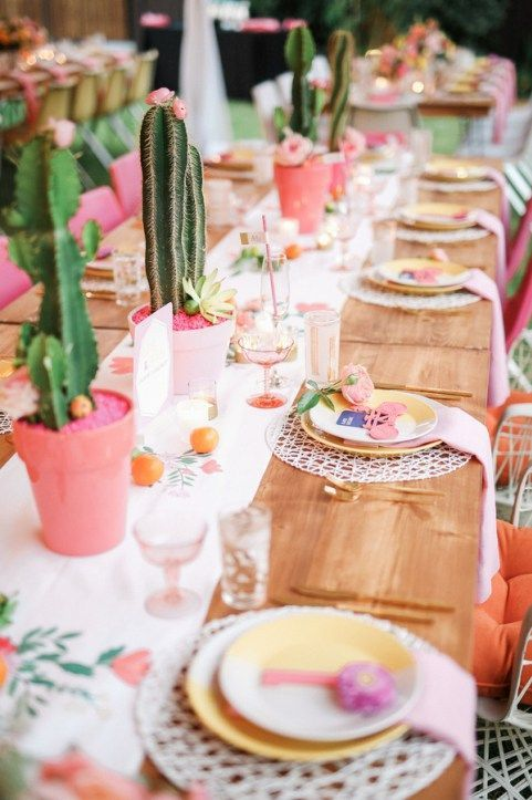 bold and pastel tablescape with cacti and a floral table runner