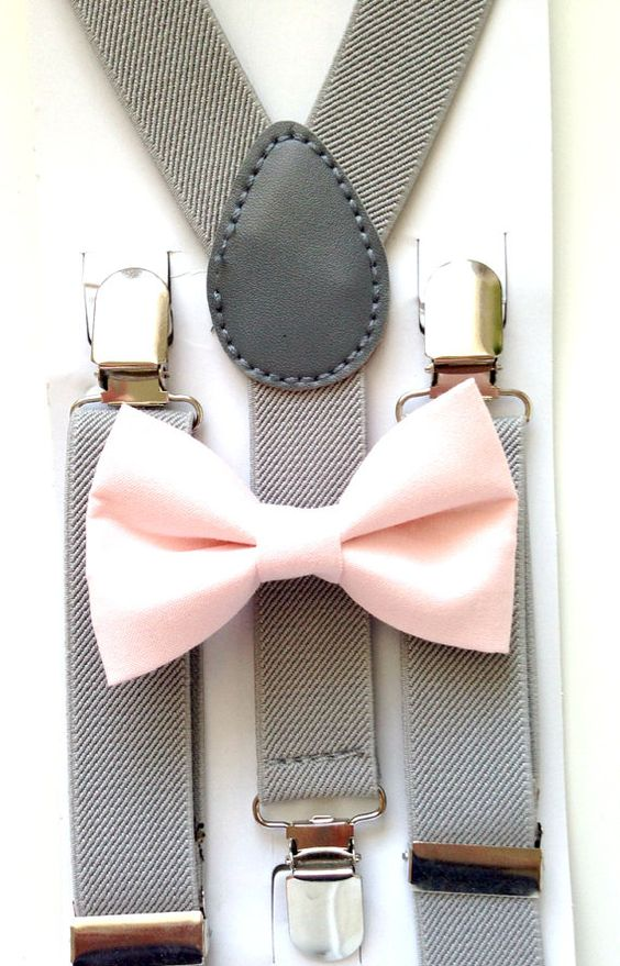 grey suspenders and a blush bow tie