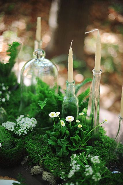 moss and greenery and candles table runner