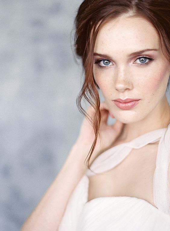 romantic neutral makeup with a nude shiny lip