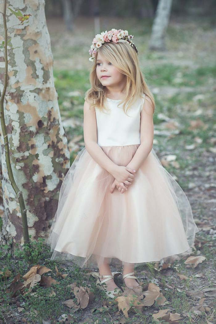 white plain bodice and a nude-colored layered tulle skirt