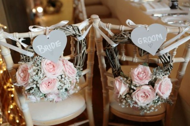 blush roses, baby's breath and grey hearts for chair decor