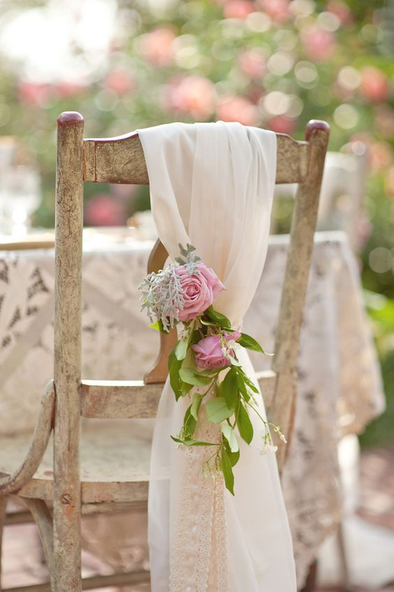chairs with fabric and floral posies