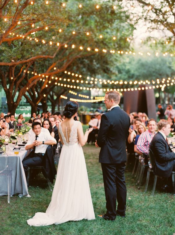 romantic string light outdoor reception