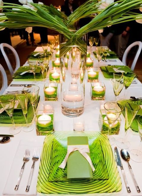tropical table decor with greenery glass plates and placemats and candles