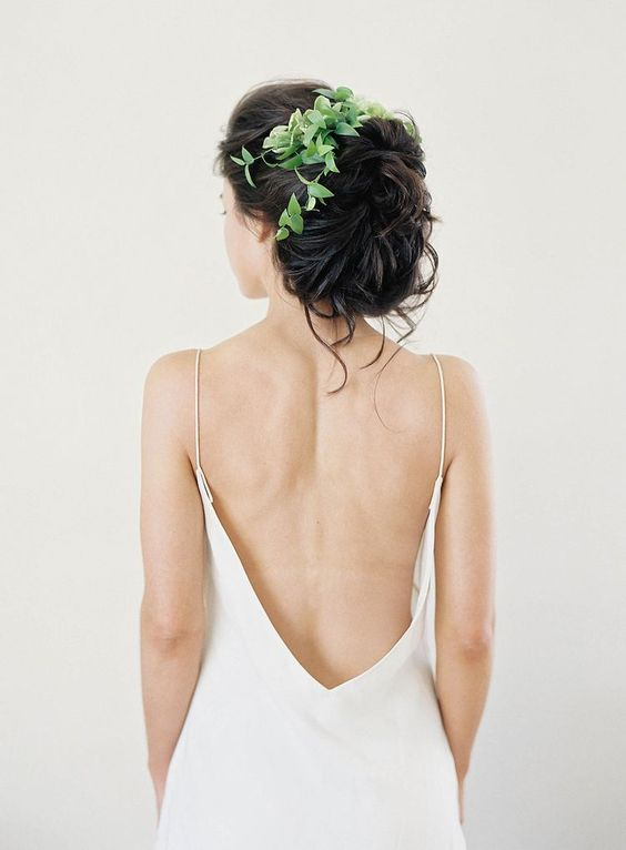 bridal wavy updo with fresh green leaves