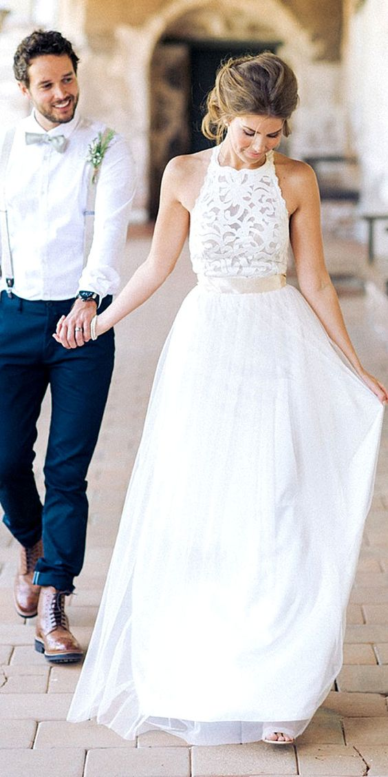 lace bodice and a flowy skirt with a sash to highlight the waistline