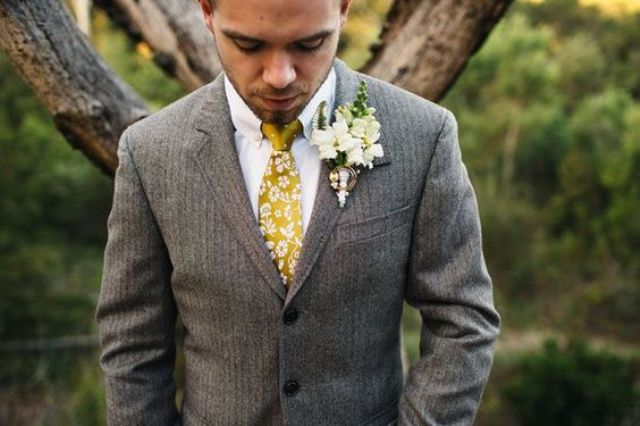 light brown suit, a white shirt and a yellow tie