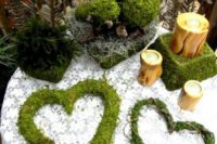 20 moss hearts, stands and topiaries are great for woodland decor