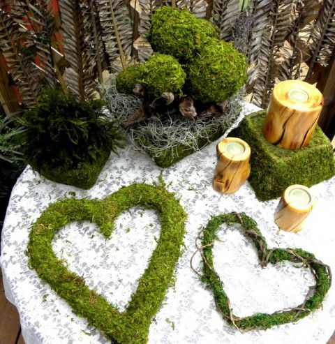 moss hearts, stands and topiaries are great for woodland decor