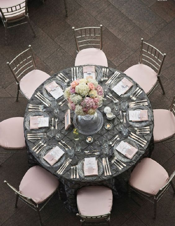 dark grey tablecloth and blush napkins and chairs