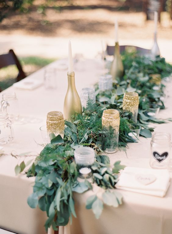 gold bottle candle holders and glitter mason jars