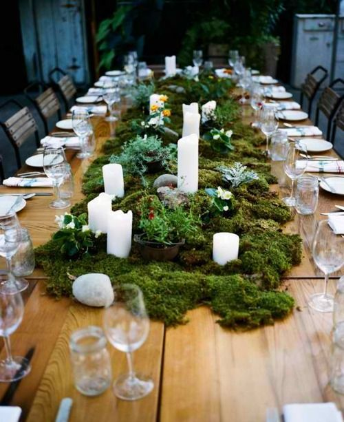 moss woodland table runner with candles and greenery