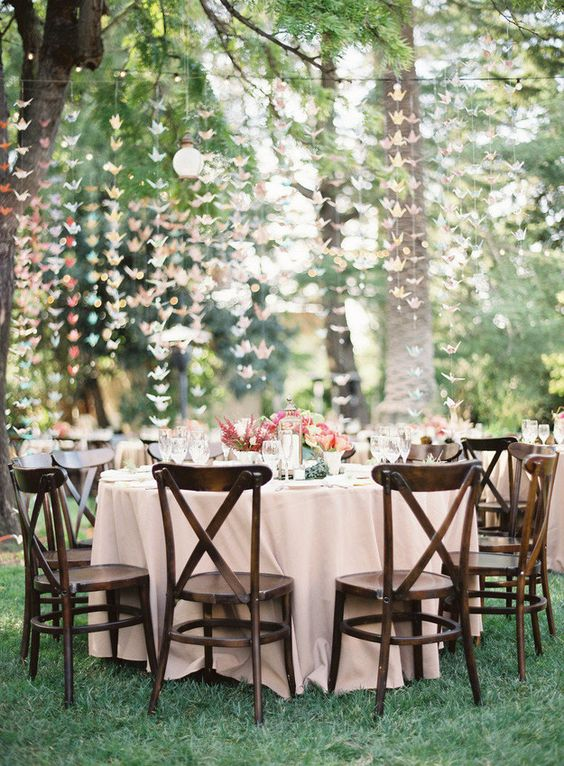 pastel reception with origami garlands hanging