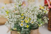 21 wood slice with daisies in jars wrapped with twine