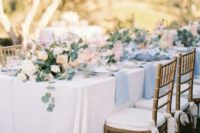 22 outdoor wedding reception in white and serenity blue with greenry