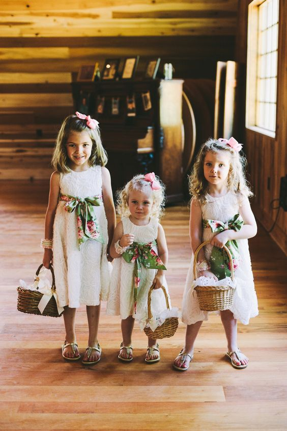 white lace dresses with colorful floral sashes