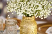 22 wood slice with a glitter mason jar and baby's breath