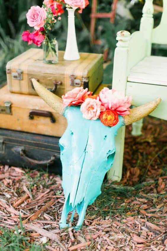 colorful skulls with flowers are a great idea to decorate a boho wedding
