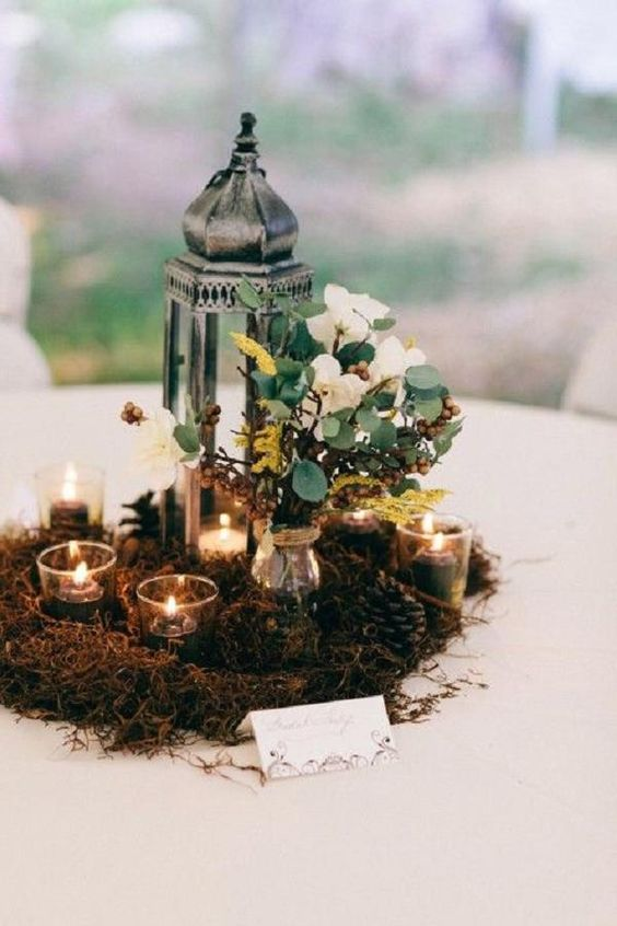 moss, greenery and flowwers, candles for a cute centerpiece