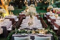 23 outdoor spring wedidng reception with fresh greenery and hanging lights