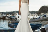24 deep plunging sweetheart neckline dress with an embellished bodice by Julie Vino