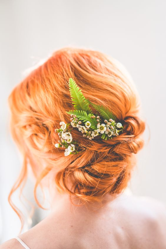ginger red hair bride with a wavy updo, fern and flowers