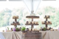 26 a barrel and wood slice cupcake stands for displaying food