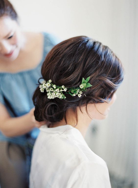medium length hair updo with lilies of the valley