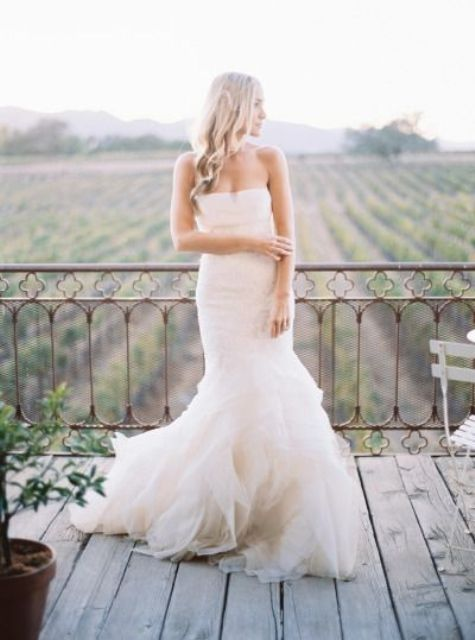 strapless ivory wedding dress with a mermaid silhouette by Vera Wang