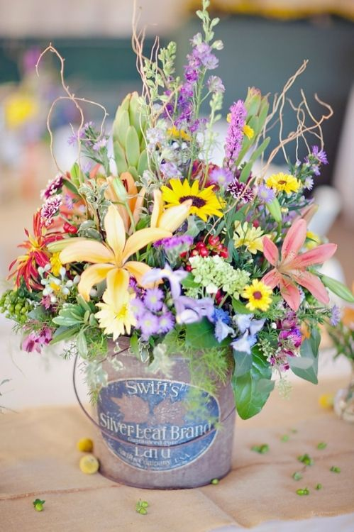 wildflower wedding centerpiece in a paint bucket