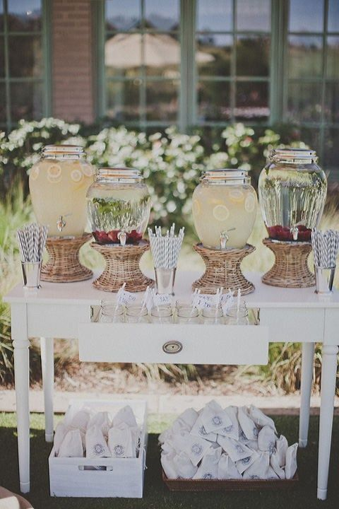 rustic wedding drink bar with baskets and straws