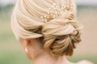 27 simple low bun updo with a pearl hairpiece
