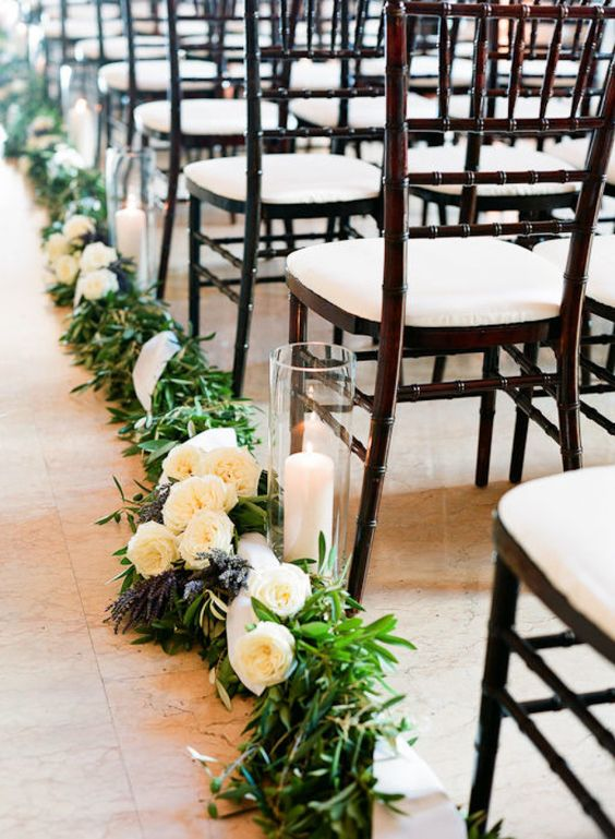 greenery and ivory roses garland with candles