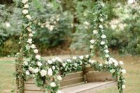 28 hanging bench with lush greenery