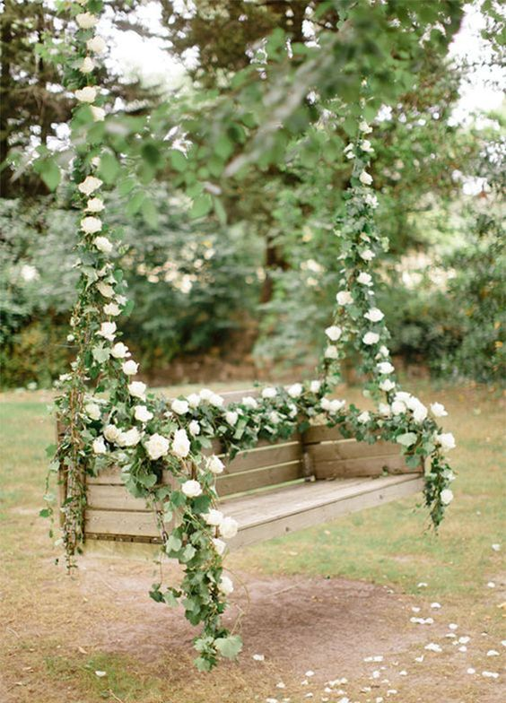 hanging bench with lush greenery